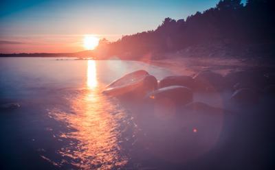 Огни заката закат финский залив волны вода камни пляж песок солнце берег цвета небо длинная выдержка