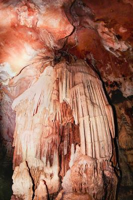 Centuries-old leaks in the cave. archaeological bones cave cavern curiosity damp dark discovery erosion formation geology group historical hole illuminated indoors inside karst limestone minerals monument nature opening orange rock stalactite tourists underground visiting water