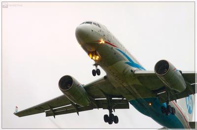 Новая ТУшка самолет дождь посадка