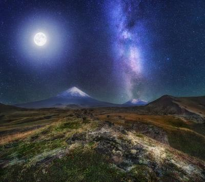 MOON RISING ABOVE THE VOLCANO