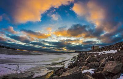 Первый февральский закат Финский залив закат облака дамба Кронштадт лёд лед камни снег море зима небо