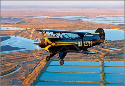 """Виктор Чмаль в """"Pitts S2B"""" над низовьями Дона. Pitts самолёт закат В.Н.Чмаль"""