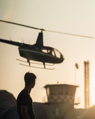Fly away. mdpphoto street helicopter peoples flyaway sunset man streetportrait