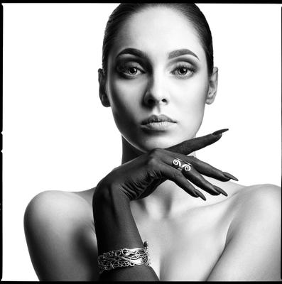 Model with bracelet and ring girl look eyes lips black hand jewelry ring bracelet