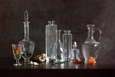 The Edge Of Emptiness glassware bottles glass sea shells light reflections emptiness