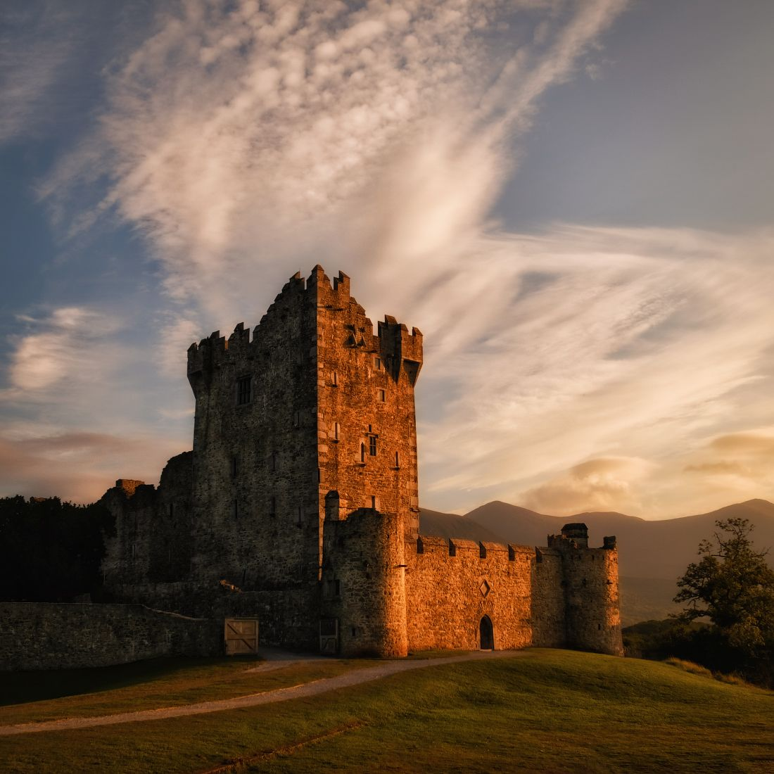 ...Ross castle... ireland kerry killarney ross castle sunset mountains landscape architechture old history ancientmfortress tower stone sky clouds cloudscape outdoors scenic scenery dramatic picturesque europe